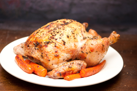 rustic food: healthy free range organic roasted chicken with herbs and crispy skin