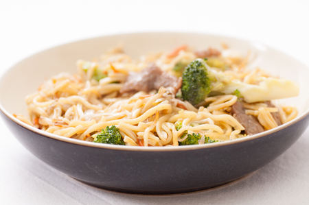 lo mein: bchow mein with beef sliced and vegetables, or chow mien Stock Photo