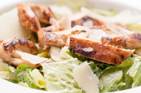 caesar salad: caesar salad topped with grilled chicken and shaved parmesan cheese