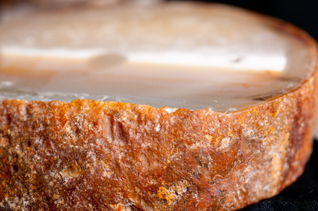 carnelian: rough round mineral sample of agate crystal with crust