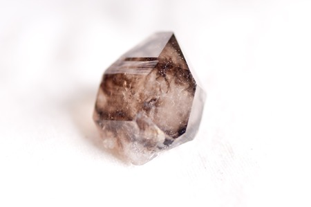 quartz crystal: smoky quartz crystal mineral sample used for jewelry or manufacturing
