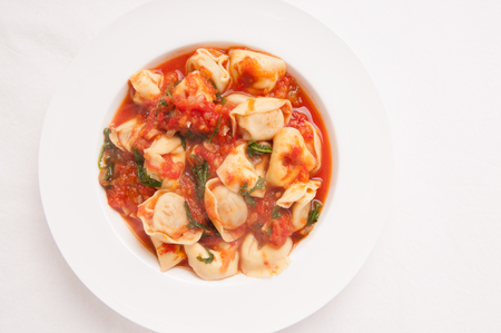 stuffed tortellini: tortellini stuffed with cheese in a creamy tomato and parmesan cheese sauce