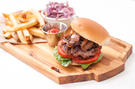 cole: handmade hamburger with mushrooms and homemade french fries and cole slaw Stock Photo