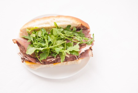 french roll: rare roast beef on a submarine bun with cheddar cheese