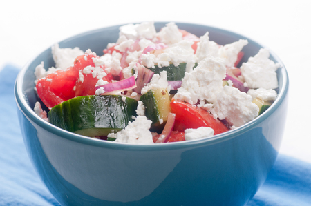 heathy diet: organic tomato and cucumber greek salad with feta and spanish onion