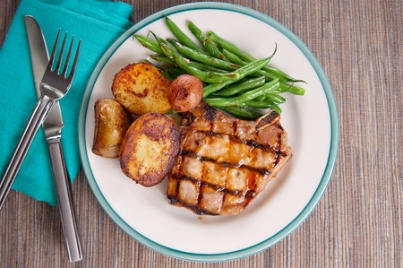 chops: organic pork chop with pan sauteed potatoes and green beans with a peach sauce
