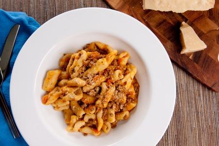 handmade cavatelli pasta with a rich meat tomato sauce Stock Photo