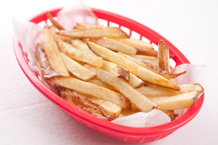 hand cut: hand cut organic french fries in a red basket
