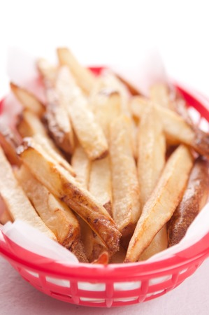 hand cut: hand cut organic french fries in a red backet