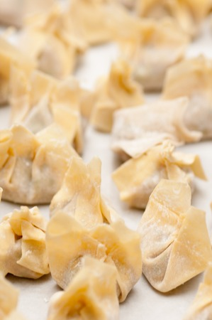 won: hand made won tons stuffed with pork in a delicious broth