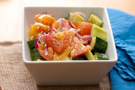 heathy diet: healthy local farm salad greek style with feta, heirloom tomato and cucumber
