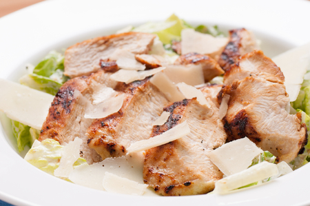 chicken caesar salad: caesar salad topped with grilled chicken and shaved parmesan cheese
