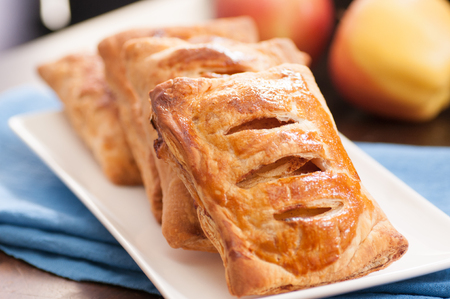 sweet pastry: puff pastry apple pastry turnovers for dessert Stock Photo