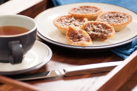 crust: delicious butter tarts with raisins and a flaky crust