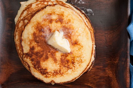 flapjacks: a stack of hamemade pancakes with butter