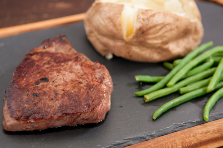 ejotes: tenderloin steak with baked potato and green beans