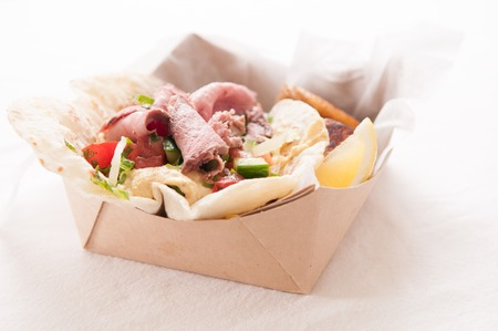 donner: food truck meal of lamb wrap with roasted potato, shawarma style with hummus Stock Photo