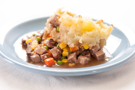 smothered: tasty cottage or shepherds pie with fresh lmab and vegetables smothered in mashed potatoes