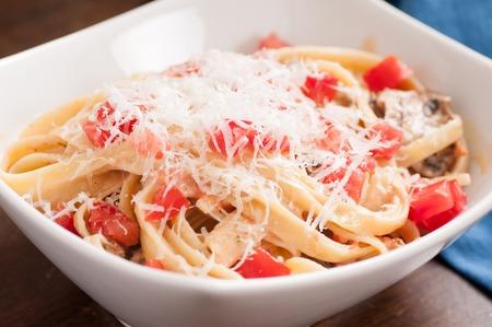 alfredo: creamy alfredo fettucini pasta with crimini mushrooms and fresh tomatoes topped with parmesan