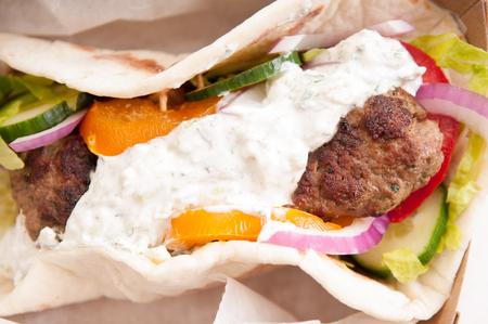 kabab: delicious flatbread wrap koobideh, iranian skewer with fresh vegetables and tzatziki sauce