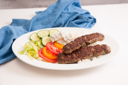 tzatziki: delicious flatbread wrap koobideh, iranian skewer with fresh vegetables and tzatziki sauce