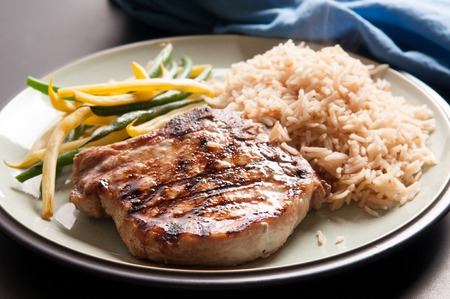 grilled pork chop: grilled pork chop with rice and steam vegetables