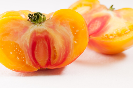 heirloom: beautiful ripe heirloom tomato sliced in half Stock Photo