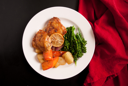 muslos: crispy chicken thighs with fingerling potatoes, carrots and green vegetables