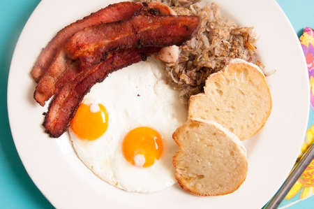 sunny side: sunny side up eggs with organic bacon, hashbrowns and crsipy toast Stock Photo