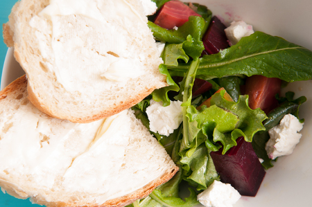 home made: beet and goat cheese salad with home made bread Stock Photo