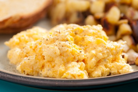 free range: free range farm fresh eggs scambled with toast and hashbrowns Stock Photo