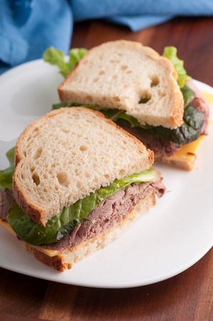 hero sandwich: roast beef sandwich with cheese, take out style from a deli Stock Photo