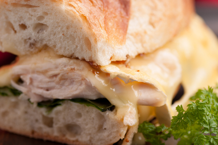 brie melted on chicken on a baguette bread roll Stock Photo