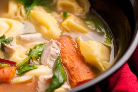 rich pasta tortellini soup with chicken and fresh vegetables