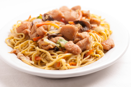 chow mien or mein with chicken and fresh vegetables