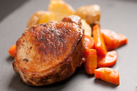 pork chop stuffed with apple with potatoes and carrots