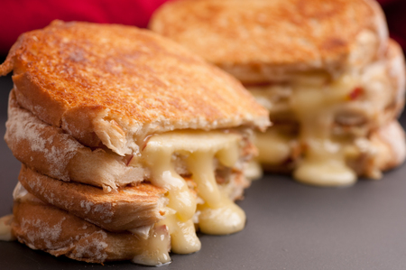 grilled cheese sandwiches with apple and brie, take out style Stock Photo