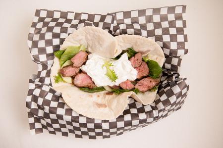 gyro or souvlaki lamb wrap with tzatziki