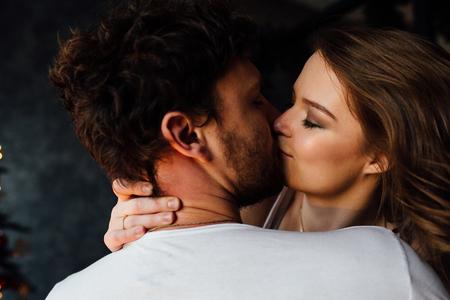 passionate kiss: Happy couple of lovers in pajamas. embracing hug, passionate kiss.