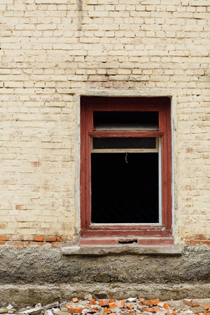 without window: Window without glass in an abandoned brick building, devastation