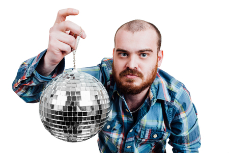 interrogativa: Portrait of a red-bearded, balding male brutal. White isolated background. A man in a blue plaid shirt, holding disco ball in hand. It shows a finger. Interrogative looking at the camera