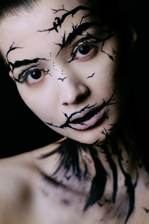 beautiful woman with creative make-up halloween tree make-up Zdjęcie Seryjne