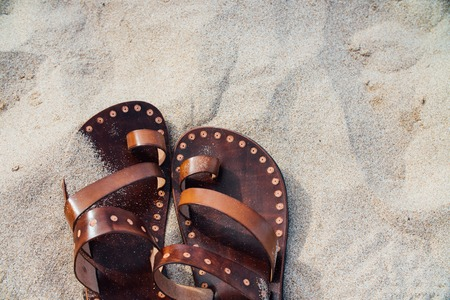 Vintage leather sandals handmade on the sand. Nobody