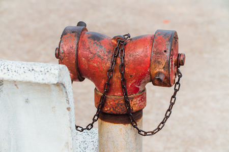 Red fire hydrant with chain.