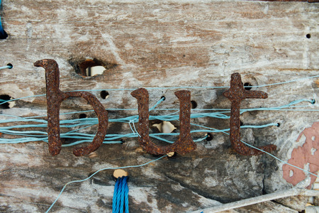 majuscule: Old iron letters. Vintage signboard with text from iron corrosion letters signs