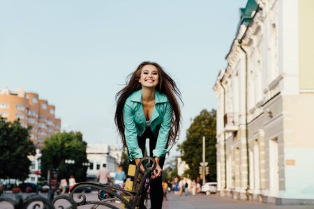 young happy girl, having fun, jumps and has fun on the street. Lifestyle.