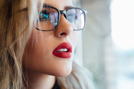 Close up portrait of a female wearing an eyewear looking to the far distance Imagens - 101965064