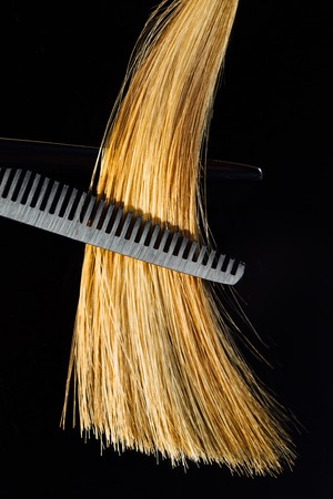 Professional scissors stylist hairdresser on the background of healthy beautiful hair. An example of a tester. Stock Photo