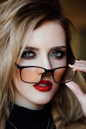 portrait of a girl in glasses.