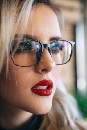 Glasses eyewear woman portrait looking away. Close up portrait of female.